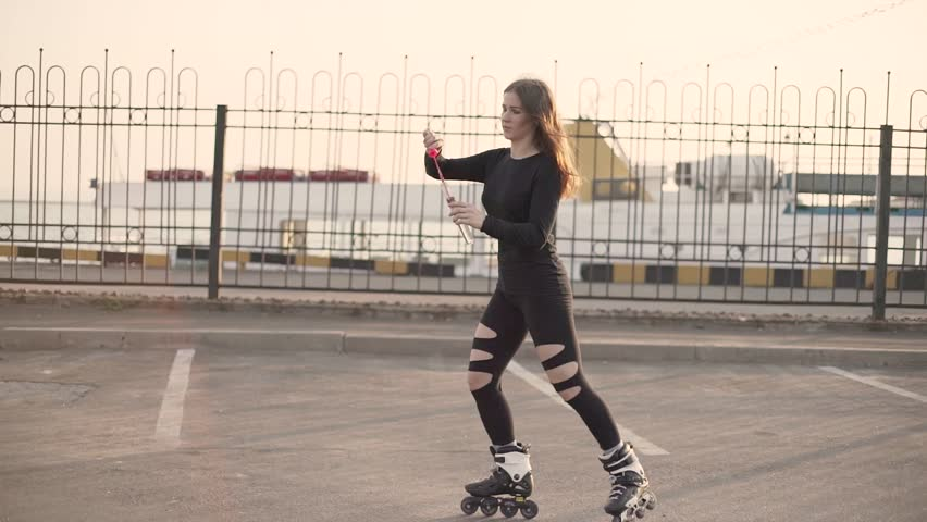 Woman skating near the sea. Girl going rollerblading. Caucasian woman in outdoor activities on the sunrise with soap bubbles. slow motion #1028730998