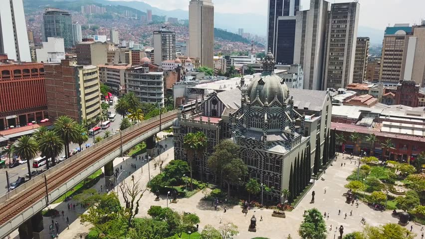 Incredible aerial shot of metro train and Botero Plaza in Medellin city center | Shutterstock HD Video #1028760938