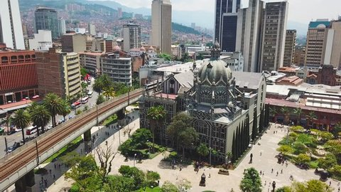 Incredible aerial shot of metro train and Botero Plaza in Medellin city center
