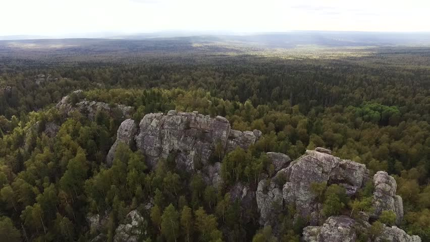 Aerial view of drone with typical Portuguese forest, crown of trees, pines and oaks, beauty of nature. Footage. A man travelling in spectacular valley with granite mountains and beautiful forest.