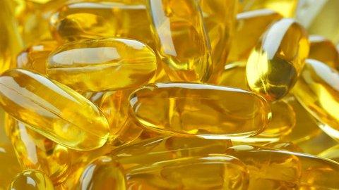 Rotation of omega 3 supplement vitamin gel capsule.