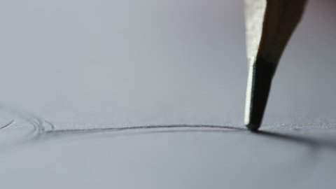 Extreme close up view of drawing pencil's rod. Drawing lines, curves, working on painting, project, blueprints. Artistic, professionalism, engineer, designer. Selective focus