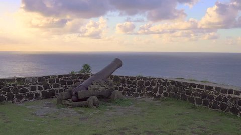 Old rusted cannon resting on top of a castle at St. Lucia, Pigeon Island.