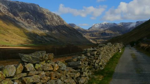 A Camera Track across a wall and road in the beautiful Nant Ffrancon Pass in Wales in the UK