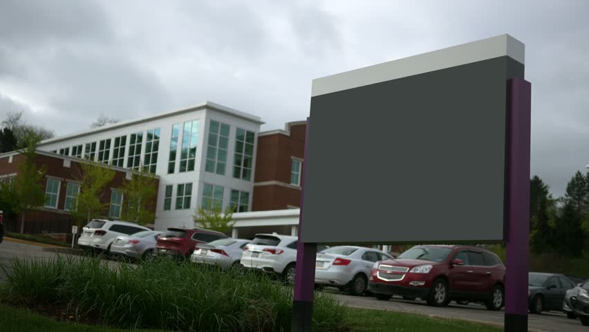 Modern blank establishing shot signage with building in background
