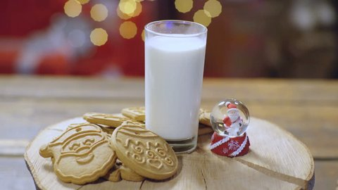 New Year's delicacies for santa. Milk and cookies for Santa Claus. Rustic Christmas background with milk and cookies to Santa. Overhead view of milk, Christmas cookies. Happy New Year and Christmas