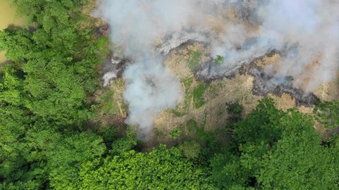 Forest fire. Deforestation. Aerial view of jungle rain forest destroyed in Southeast Asia