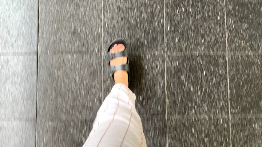 Point of view, feet in sandals shoes walking on pavement, summer lifestyle fashion | Shutterstock HD Video #1028971748