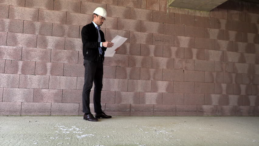 Architect inspects construction from the inside #1028983898