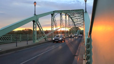 Early morning; cars are driving on Mária Valéria Bridge in Esztergom, Hungary.