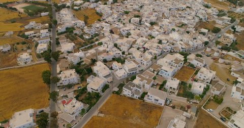 Aerial: Rooftops of a Neighborhood in Paros in Paros, Greece