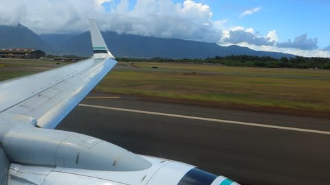 Wing Shot of Plane Taking Off in Hawaii in Maui, HI