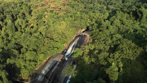 Aerial: Cascading Waterfall and Extensive Jungle View in Ilhabela, Brazil