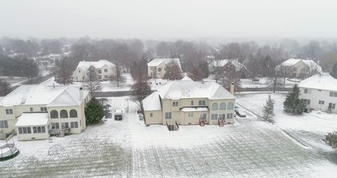 PITTSBURGH, PENNSYLVANIA, US. Winter snow on a typical city street in Pittsburgh. Deserted snow-covered suburban residential quarter - aerial 4K view.