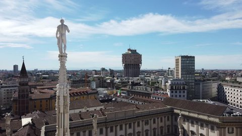 Milano, Italy. April 27, 2019. Panorama of the city and the skyscraper from the roof terrace of the cathedral. The white marble spires of the Duomo