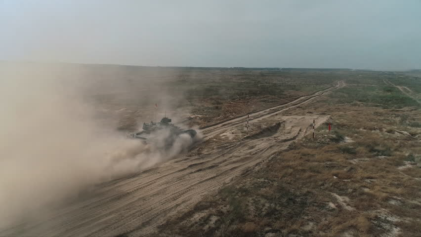 Aerial View Military Army Tank Shooting. Heavy Combat Fighting Vehicle Training in Sand Back View. Battlefield Advanced Technology/ Drone Shot Footage 4K (UHD) | Shutterstock HD Video #1029080648