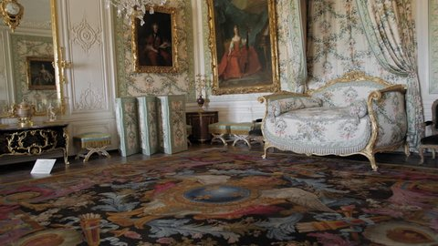 Versailles, PARIS, FRANCE- August 2018: Luxurious interior of the royal palace. Medieval boudoir and imeratritsy, huge rare paintings and frescoes. Sofa, dressing table. Slow Motion.
