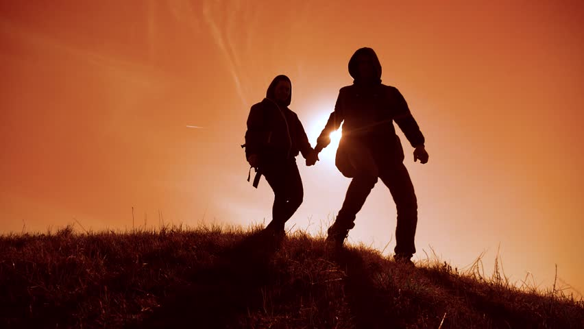 Happy family man and woman business travel teamwork walking go hand in hand silhouette of tourists on top of mountain lifestyle sunlight. couple man and girl with backpacks and a dog go at sunset | Shutterstock HD Video #1029114668