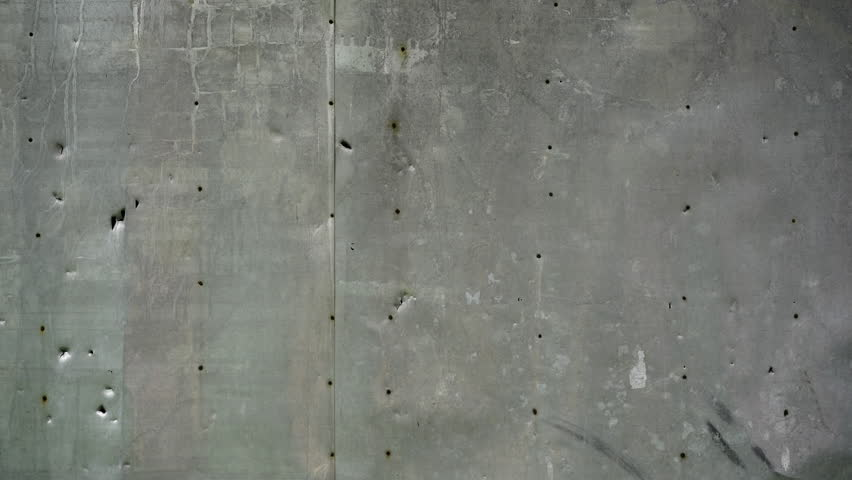 4K. Metal rusty grey real dirty wall. Seamless texture. Grunge grey background pattern. Cement and sand cracked wall of tone vintage for backdrop or decoration. Graffiti wall.