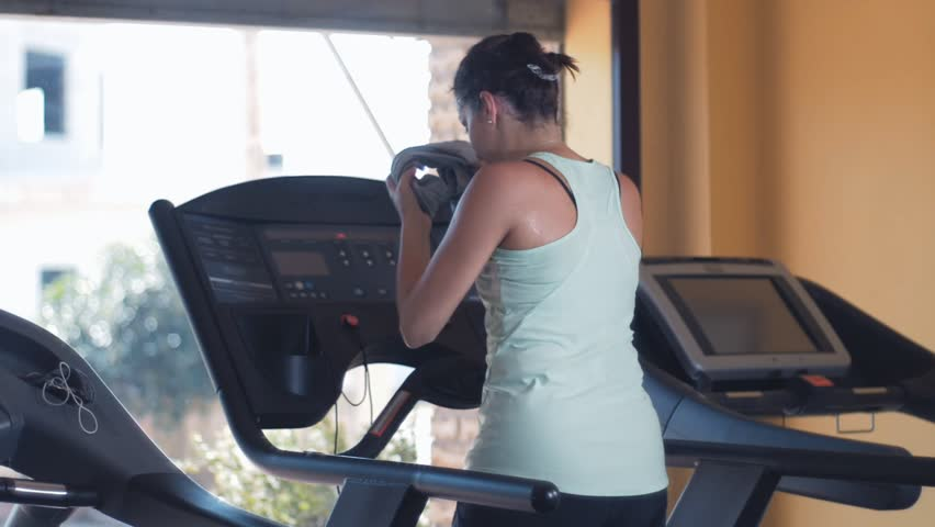 Fitness, workout, gym. Young sportive woman running on treadmill- slow motion | Shutterstock HD Video #1029178748