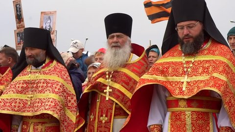 Komsomolsk, Russia - May 5, 2019: Religious procession, priests in robes and epitrachyls sing the prayer and religious hymn, baptized