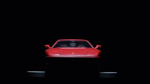 Izmir, Turkey - May 11, 2019. Rotating Red Ferrari TB 348 Toy car on a black background.