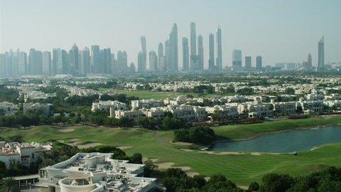 Aerial Dubai luxury homes Emirates Hills Golf Persian Gulf UAE