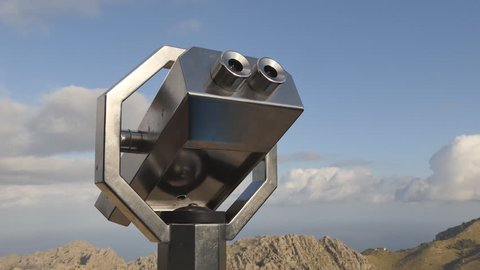 Binoculars looking out on to mountains in Europe.