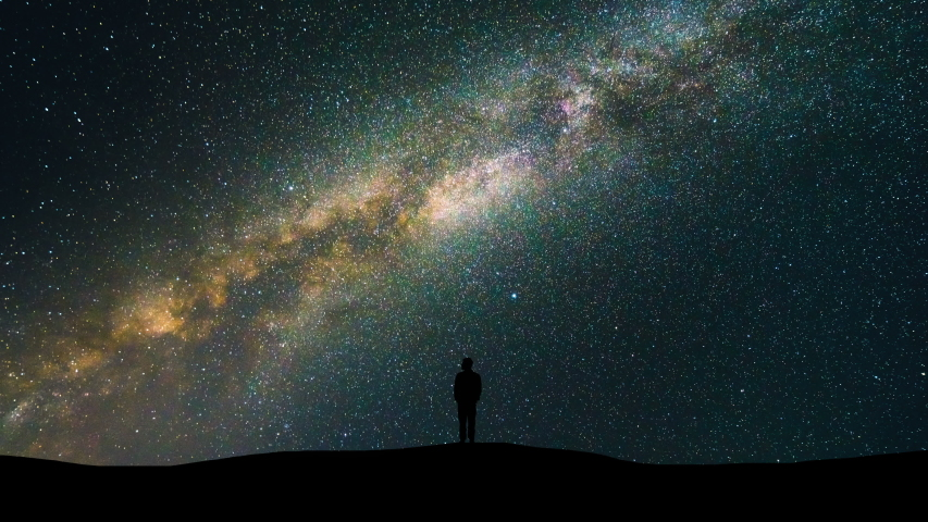 The man standing on the starry sky background. time lapse #1029435818