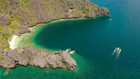 aerial view tropical lagoon with sandy beach surrounded by cliffs. El nido, Philippines, Palawan. beautiful lagoon and karst scenery.