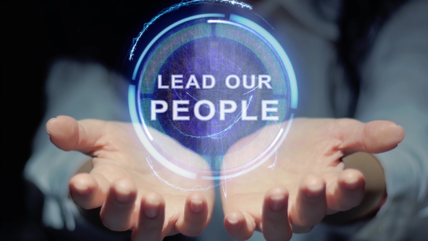 Female hands show a round conceptual hologram with text Lead our people. Unrecognizable woman in ashen white on a black background with future holographic technology | Shutterstock HD Video #1029583478