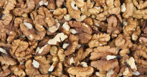 Food background. Walnut kernels rotating