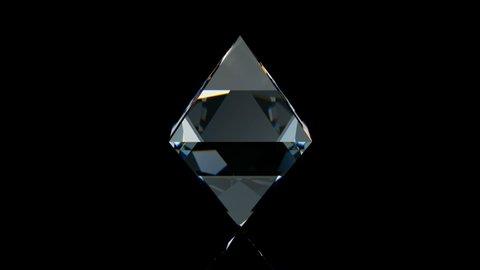 Ideal octahedron diamond rotating on black glossy background. 3D seamless loop animation