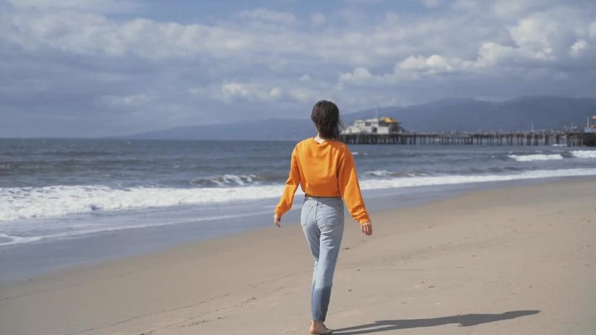 Attractive barefoot girl on Santa Monica beach   Shutterstock HD Video #1029727568