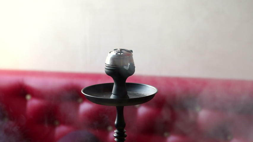 A Modern Glass Hookah Stands On A Table In A Modern Hookah Bar