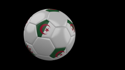 Soccer ball with flag Algeria flies past camera, slow motion blur, 4k footage with alpha channel