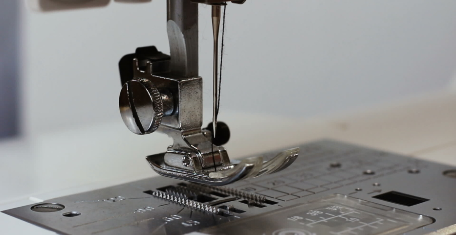 Man seamstress hand holding cloth behind sewing machine sew fabric for textiles and clothing. Close up of work process of sewing machine in atelier. Textile industry, manufacturing and fashion | Shutterstock HD Video #1029825518