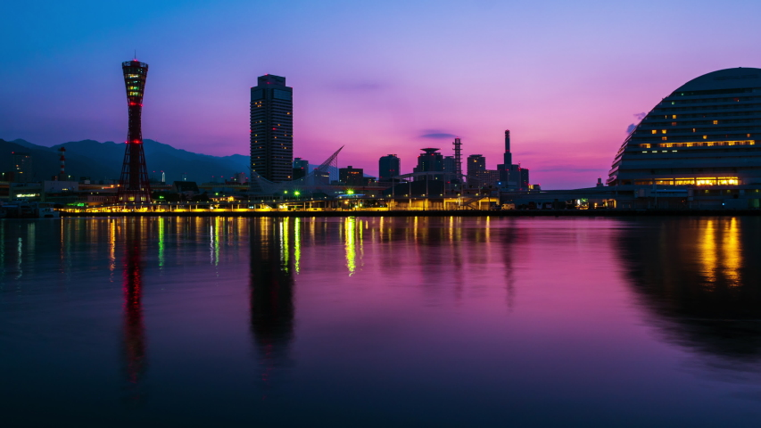 Kobe, Japan. View of sunrise in Kobe, Japan. Time-lapse of cloudless sky with harbor and numerous skyscrapers, zoom in | Shutterstock HD Video #1029915188