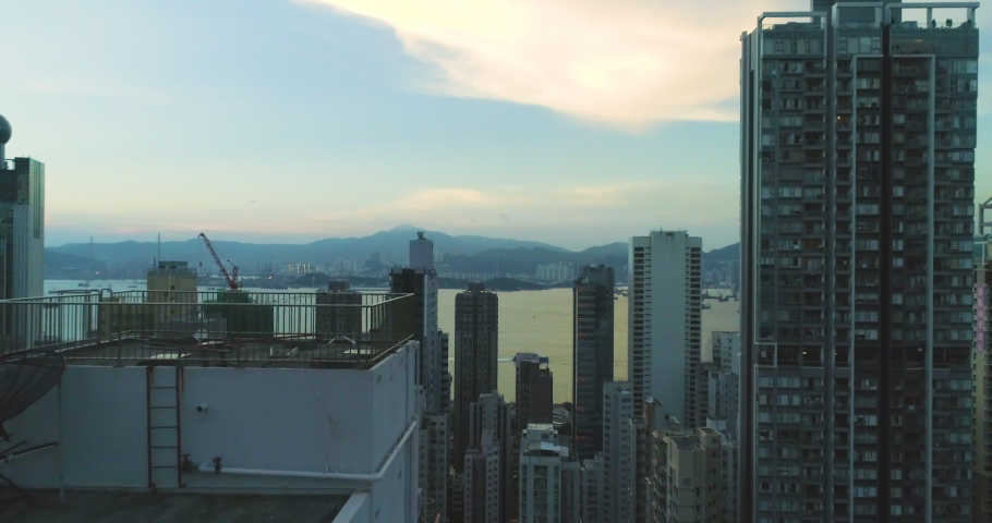 Urban cityscape 4K. View of modern skyscraper buildings In Hong Kong. Scenery of overcrowded narrow apartments | Shutterstock HD Video #1029987008