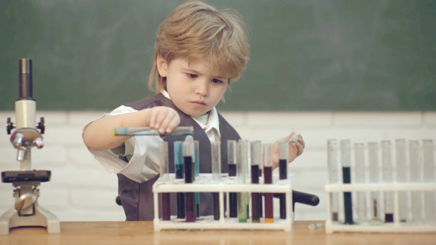 September 1. Concept of education and teaching. Lab microscope and testing tubes. Home schooling. My chemistry experiment. Junior year chemistry   Shutterstock HD Video #1030042268