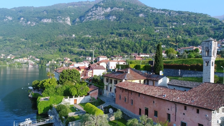 Village and bell tower of Ossuccio (Lake Como, Italy). Aerial view | Shutterstock HD Video #1030093748
