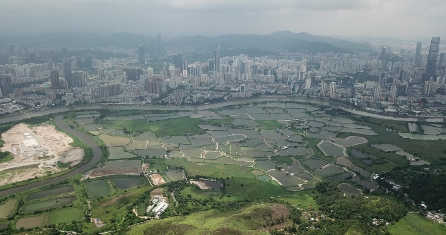 Aerial view of beautiful landscape near border of New Territories, Hong Kong. Well developed Shenzhen is in opposite side  | Shutterstock HD Video #1030104668