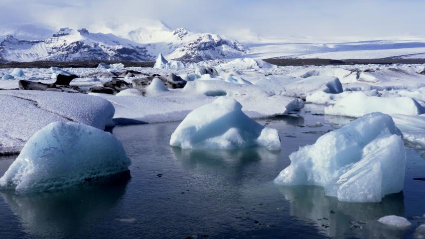 Timelapse of Icebergs moving in Jokulsarlon Ice Lagoon Iceland   Shutterstock HD Video #1030216868