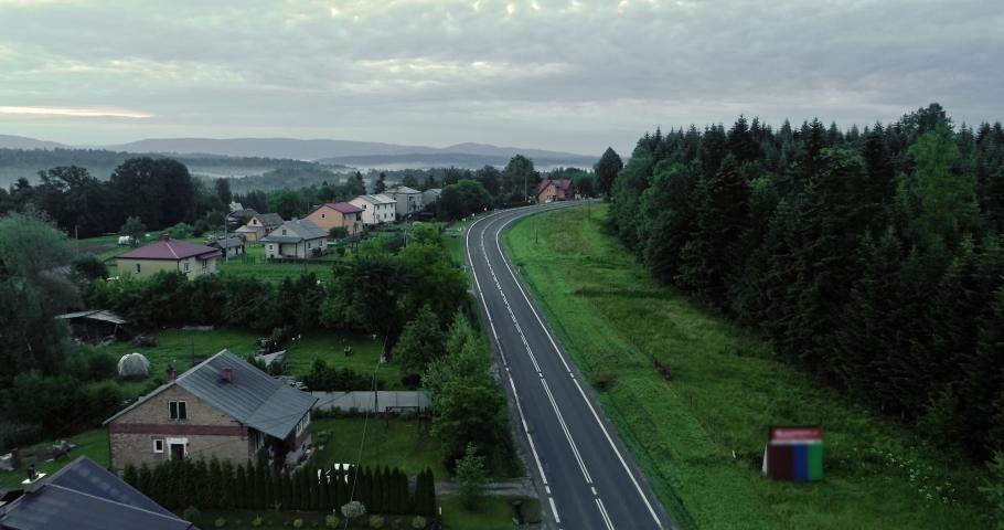 The drone flies over the village in Bieszczady. | Shutterstock HD Video #1030240268