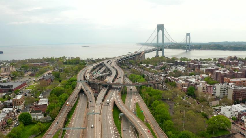 Verrazzano-Narrows bridge in Brooklyn and Staten Island. Huge highway intersection aerial view. | Shutterstock HD Video #1030256528