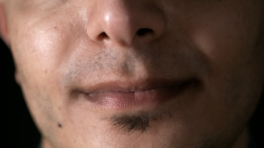 Macro of male lower face, mouth and toothy smile | Shutterstock HD Video #1030257668