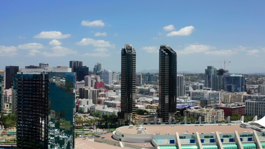 Aerial footage over the city of San Diego on a bright sunny day with blue skies. San Diego, Southern California.  | Shutterstock HD Video #1030356068