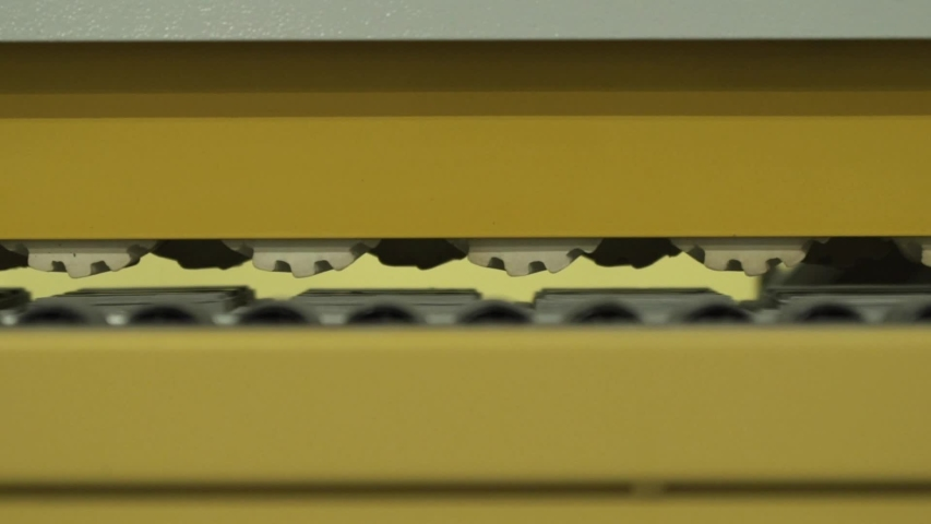 Close-up of moving mechanisms of yellow milling machine in a working room of factory or industrial plant. Action. Woodworking industry | Shutterstock HD Video #1030558148