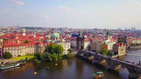Aerial footage of Prague, Czech Republic, on a Beautiful summer's day over the city, including Charles Bridge and Prague One municipal district.