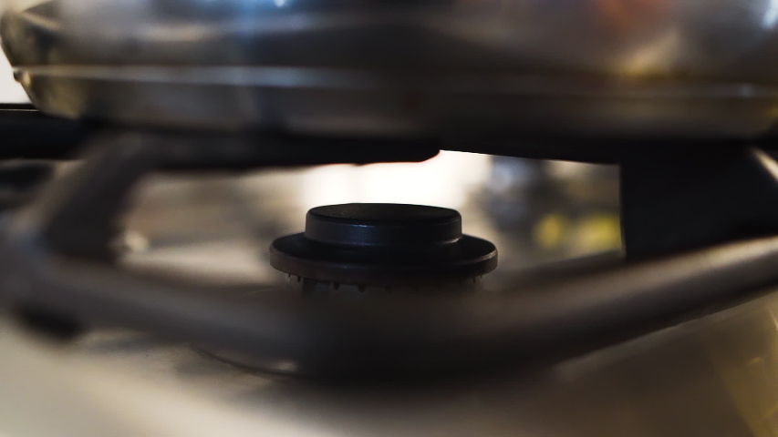 Igniting a flame on a gas stovetop in slow motion | Shutterstock HD Video #1030614248